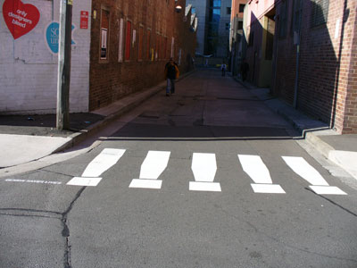 Fake pedestrian crossing, 'Design saves lives', an entrant in the Eye Saw exhibition in Omnibus Lane, Ultimo during Sydney Design Week, 2006 (photo by meganix).