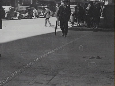A stopping line at the intersection of Market and Pitts Streets in Sydney, marked out with metal studs, 1929 (City of Sydney Archives photograph, SRC7806, file 034\034213).