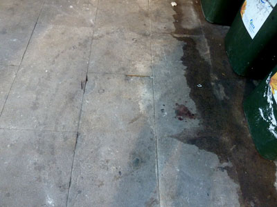 Blood on the flagstones, King Street, Sydney (2011).