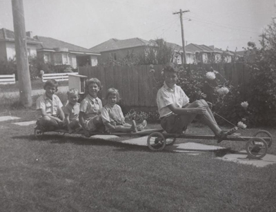 Children on a billycart with a trailer in the Melbourne suburb of Mount Waverley, 1961.